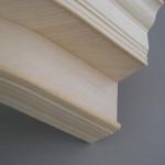 Particolare cornice in legno curvato